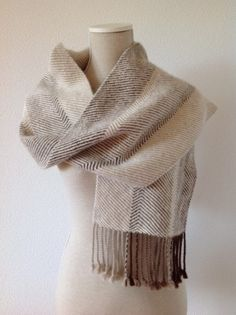 This scarf is hand-woven, made from 100% Alpaca, in the colours off white, light camel, light brown, medium brown. Alpaca wool is light and fluffy, it