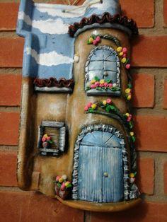 Telha decorada  com bisqui
