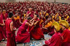 Debating Monks at Bylakuppe, Karnataka, India photographed by Steve McCurry