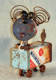 No artist listed. Cans, cracker can, springs, wire. No inspiration listed but dog junkyard. Sold to public.