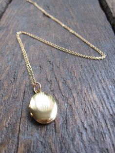 Little Vintage Gold Locket by charlieandmarcelle on Etsy, $27.00