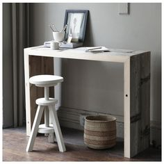 a beautiful grey and wood workspace