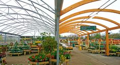 A hybrid canopy, a first of its kind for a garden centre, utilised CE marked steel and glulaminated timber to provide an aesthetically pleasing outdoor sales area for Lechlade. Mark Steel, Garden Centre, Plant Nursery, Canopies, Greenhouses, Nursery Ideas, Farming, Roots, Grass