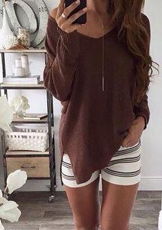 Brown sweater & stripe shorts.