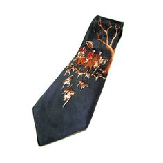 This is a beautiful one of a kind 1940s rayon tie. The body of the tie is a handsome forest green and the print depicts a traditional English fox