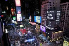 Crystal ball drops in frigid Times Square to mark 2018 - January 1, 2017.  Revelers wait for midnight during New Year's celebrations in Times Square as seen from the Marriott Marquis in New York, Sunday, Dec. 31, 2017. New Yorkers, celebrity entertainers and tourists from around the world are packing into a frigid Times Square, Sunday to mark the start of 2018 with a glittering crystal ball drop, a burst of more than a ton of confetti and midnight fireworks. (AP Photo/Seth Wenig)