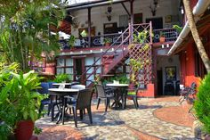 The Panjim Inn is a small and welcoming family-run property set in the heart of Fontainhas, Panjim's fascinating Latin Quarter. Latin Quarter, Indian Homes, Goa, Contemporary Design, Places Ive Been, Portugal, Corner, House Design, Patio