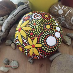 FREE SHIPPING! Hand Painted River Rock - yellow shades of orange collection #41 4 X 4 X 1 - Total Weight - 24 ounces Mandala Inspired Design - Home Decor -Zen Art - Weather Resistant Lacquer Finish A simple stone washed down river from some other place - now a smaller piece of something grander - becomes a natural and surprisingly fitting canvas. The stones size, shape, color, surface texture, even it's weight influences the design & inspires the outcome. As in nature no two ethereal & ea...