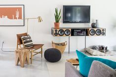 Shop Similar: EQ3 Square Teak Accent Stool, Similar: Leather Sling Chair, Similar: Westex Urban Loft Southwest Throw Pillow, Brass Floor Lamp, Similar: Knitted Graphite Pouf, Similar: Woodland Imports Attractive Sea Grass Basket, Hairpinlegs.com | Furniture Legs & Fixtures, Chevron Dog Bed and more