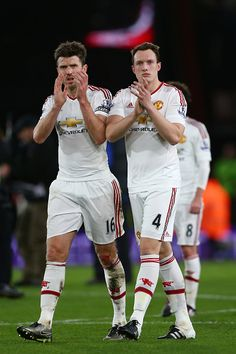 Michael Carrick and Phil Jones of Manchester United applaud fans after the Barclays Premier League match between AFC Bournemouth and Manchester...