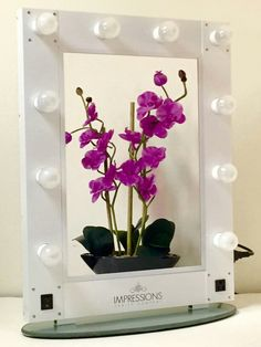 """The """"Hollywood Glam Mirror"""" is Available for purchase with 4 color options and 3 color options for LED globe style bulbs. Visit us at www.ImpressionsVanity.com for full details. #vanitylights #vanitymirror"""