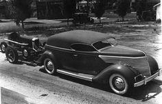 Chopped 1936 Ford hauling flat track racer.