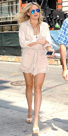 We've never been so excited about the color khaki. Kate Hudson makes it look cool thanks to a military-inspired cinch-waist jacket worn over itsy-bitsy matching shorts and a white top, plus enviable add-ons: reflective aviators, a beaded necklace and stacked peep-toes.