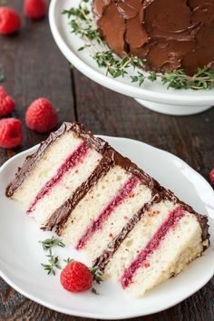 Six glorious layers of vanilla cake with raspberry sauce and a rich dark chocolate frosting. | livforcake.com