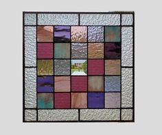 This stained glass panel window is a geometric abstract 13 1/4 x 13 1/4 inches with several different textures and colors of purple glass. The outside frame is done in clear granite glass. There is 1 bevel square in the center.  The patina on the solder is done in black and the frame is zinc left as a silver tone. There are rings on top so that the piece can be hung. To see more abstract geometric panels http://www.etsy.com/shop/sghovel?section_id=10763111  To see all of my items…