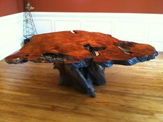 how many barbie doll shoes did  lose inside one of these? How many bumps on the head? Love me a redwood burl table!