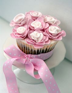Pink little flowers cupcake with a ribbon :)