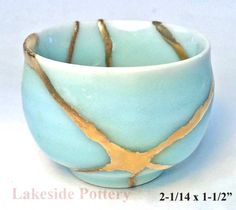 lakesidepottery.com Media JPG_Images kintsugi-gold-and-lacquer-broken-pottery-repair kintsugi-sale-2015 torquise-kintsugi-cup-2a.jpg