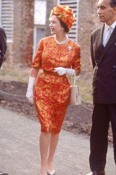 Look at Queen Elizabeth's Shoe Style Queen Elizabeth II, wearing an orange dress and tan pumps, arrives at Antigua in Young Queen Elizabeth, Princess Elizabeth, Windsor, Queen Hat, King Queen, God Save The Queen, Tan Pumps, Royal Queen, Royal Clothing