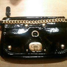 JUICY COUTURE WRISTLET Black With Gold Wristlet. Section for coins and credit card slots. Will hold good amount of stuff in the center compartment. Bags Clutches & Wristlets
