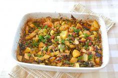 Griekse ovenschotel met aardappel, courgette, lente-ui, tomatenblokjes, dille, doperwt
