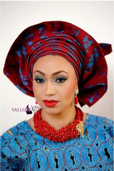 Gorgeous combination of red on teal blue traditional nigerian bridal wear, the red lip compliments the whole attite. Red and blue aso-Oke Gele with red beads