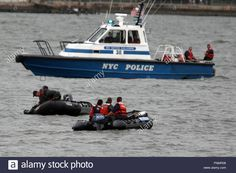 An Nypd Police Rescue Boat With S.c.u.b.a Divers Work In The Area ...