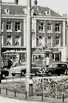 1955. A view of the Frederiksplein with tram line 4 in Amsterdam. The Frederiksplein is an extension of the Utrechtsestraat. The square, which was established after the construction of the canal belt, is located between the Weteringschans and the Sarphatistraat. On the Frederiksplein, at the location of Paleis voor Volksvlijt before it burned down in 1929, is now located the building of the De Nederlandsche Bank. #amsterdam #1955 #Frederiksplein