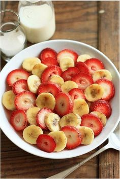 Glass of milk and a bowl of strawberries and bananas. Helloooo healthy and filling breakfast.
