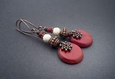 These earrings are also availbale as clip-on earrings, just ask me!   A red Tagua sequin dangles below a faceted white Howlite bead paired with a dark