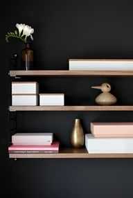 Dark walls and timber shelves