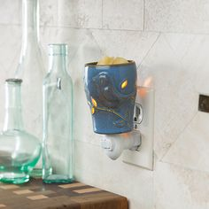 """NEW Blue Bird Plug-in Warmer 12.99 Allow 3-4 Bus Days to ShipThis warmer is glazed in a light denim blue reactive glaze and is embossed with a blue bird that will add a bit of nature to any room. Warmer Details:⦁ Length: 2.83""""⦁ Width: 2.83"""" ⦁ Height: 5.16⦁ Electrical Rating: 120V, 60Hz, 15W⦁ Bulb Type: NP7 Etc Plug-in Replacement Bulb⦁ Switch Type: Rocker Switch⦁ Rotating base allows it to fit a Vertical or Horizontal outlet ⦁ Has a removable dish⦁ Includes a warming bulb Ships from MO by…"""