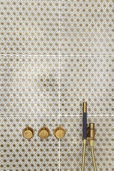 Would make showers bright and shiny Brass and gold flower shower tile and fittings ARC