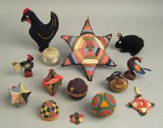 Group of needlework pin balls and pin cushions