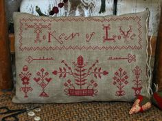 Available at HannahsPinKeep.com another beautiful primitive cross-stitch pattern by Pineberry Lane.