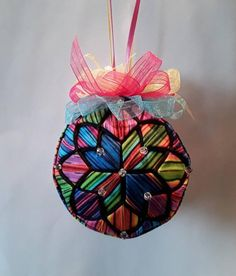 Stained glass look using striped fabric. Embellished with crystal beads and 3 colors of ribbon. Diy Quilted Christmas Ornaments, Quilted Fabric Ornaments, Christmas Balls, Christmas Crafts, Christmas Ideas, Christmas Decorations, Christmas Favors, Christmas Things, Holiday Ideas