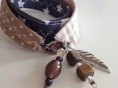 Armband aus verschiedenen Stoffen mit Perlen verziert!