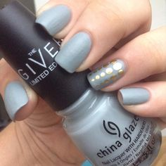 Matte gray mani with gold dots for an accent nail.