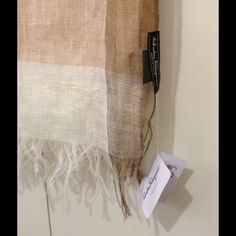 109% Authentic! Ferragamo 100% Linen Scarf 100% Authentic Plaid Linen Summer Scarf! Bought this last summer from Neimun Marcus! Never worn, with tags still on it. Could wear it a scarf or a wrap! ❤️❤️ Ferragamo Accessories Scarves & Wraps