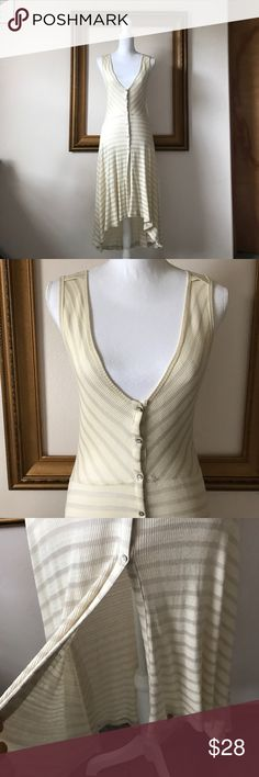 Anthro: Postal cream stripe high low tunic dress M Worn twice! Tiny hole on left back shoulder. Gorgeous piece. Soft and stretchy! 15 inches armpit to armpit. 42 inches shoulder to bottom of top in front. Anthropologie Tops Tunics