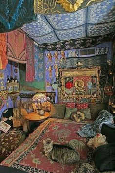 how to create a bohemian atmosphere in your home.   It's a crazy look, but there is just something about it I like. Not sure that I could live with it all around me.