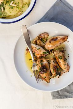 Choose the smallest squids and stuff them patiently with a few simple ingredients: stale bread soaked in milk, parsley, stir-fried tentacles and a handful of pine nuts to give flavour and a different texture. The sea taste is persistent, softened by bread and milk. Pine nuts add a surprising resi...