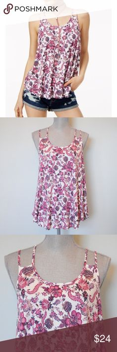 NWT Hippie Rose double strap tank top Beat the heat or enjoy the sun in Hippie Rose's tank top with double spaghetti straps, a rounded hem and a pretty print. #535  -Size large -Scoop neckline; pullover style -Double spaghetti straps -Rounded high-low hem -Easy fit; hits at hip -Rayon/spandex -Hand wash  NO trades. Bundle for additional discounts. I have permission from Macy's to use stock photos. Hippie Rose Tops Tank Tops