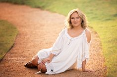 Senior photography session at sunset on dirt road in Frisco, TX