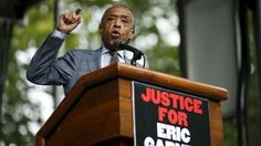 Rev. Al Sharpton speaks to protesters during a rally near a New York court on Saturday. Family and supporters marked the anniversary of the police killing of Eric Garner with rallies and vigils demanding police reforms and justice in the controversial case.