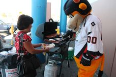 Rawhide running the grill at Hockey X Bauer Days on September 5, 2013.