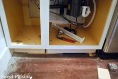 Adding base molding to builder cabinets