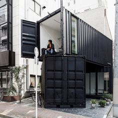 designed by tomokazu hayakawa architects three black containers have been orientated and stacked to form the office and gallery space with a garden belonging to a couple in #tokyo.  see more #shippingcontainer #architecture on #designboom! via designboom #interiordesign #decor #todesign #interiordesignshoppingguide