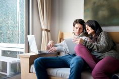 High-Res Stock Photography: Couple Relaxing On Couch With Laptop and…