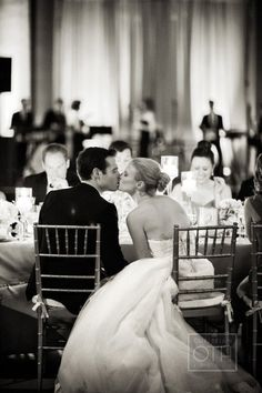 (8) Behind bride & groom seated at reception? Might not be possible because table is by wall.  ??